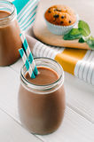 Chocolate milk in bottle with turquoise straws Stock Image