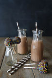 Chocolate milk with cake pops and straws Stock Image