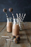 Chocolate milk with cake pops Stock Images