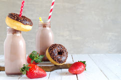 Chocolate milk with chocolate donut and strawberries Royalty Free Stock Photo