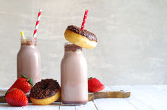 Chocolate milk with chocolate donut and strawberries Royalty Free Stock Image