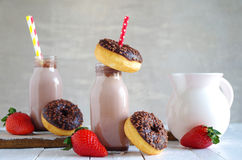Chocolate milk with chocolate donut and strawberries Stock Photos