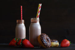 Chocolate milk with chocolate donut and strawberries Royalty Free Stock Photography