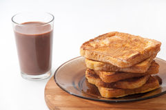 Chocolate milk and french toast arranged on a plate Royalty Free Stock Photos