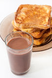 Chocolate milk and french toast arranged on a plate Stock Photo