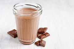 Chocolate milk with pieces of chocolate bar Stock Photo