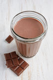 Chocolate milk with pieces of chocolate bar Royalty Free Stock Photography