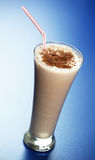 Chocolate milkshake. Chocolate drink on a blue background Royalty Free Stock Photo