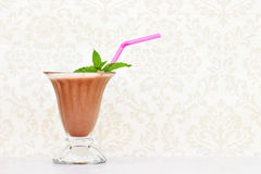 Chocolate milkshake. With mint and straw with room for your text Royalty Free Stock Images