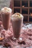 Chocolate milkshake in tall glass mugs Royalty Free Stock Photography