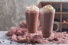 Chocolate milkshake in tall glass mugs Royalty Free Stock Photos