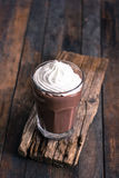 Chocolate milkshake with whipped cream Royalty Free Stock Photos