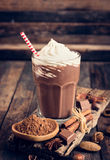 Chocolate milkshake with whipped cream Stock Images