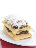 Chocolate mille-feuille. A delicious dessert made of phyllo,chocolate cream and icing sugar stock photos