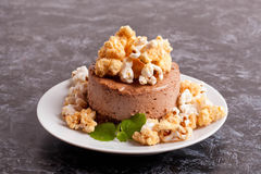 Chocolate mini-cake with caramel and popcorn, decorated mint Royalty Free Stock Photos