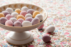 Chocolate mini eggs in a bowl. Easter chocolate mini eggs in a pretty antique china bowl stock photography