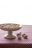 Chocolate mini eggs in a bowl. Easter chocolate mini eggs in a pretty antique china bowl stock images