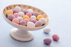 Chocolate mini eggs in a bowl. Easter chocolate mini eggs in a pretty antique china bowl stock photo
