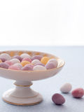Chocolate mini eggs in a bowl. Easter chocolate mini eggs in a pretty antique china bowl royalty free stock images