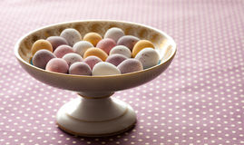 Chocolate mini eggs in a bowl. Easter chocolate mini eggs in a pretty antique china bowl stock image