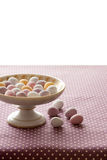 Chocolate mini eggs in a bowl. Easter chocolate mini eggs in a pretty antique china bowl royalty free stock photos