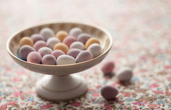 Chocolate mini eggs in a bowl. Easter chocolate mini eggs in a pretty antique china bowl stock photos