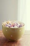 Chocolate mini eggs in a bowl Stock Image