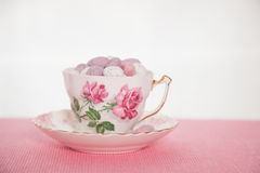 Chocolate mini eggs. Easter chocolate mini eggs in a bone china tea cup painted with pink roses royalty free stock photos
