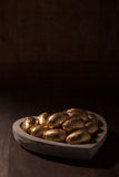 Chocolate mini eggs, wrapped in gold foil Stock Photography