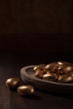 Chocolate mini eggs, wrapped in gold foil Royalty Free Stock Photo