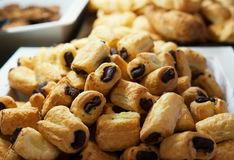 Chocolate mini rolls on a large tray at the breakfast bar stock photo
