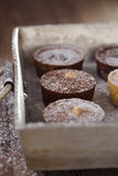 Chocolate  Mini Tartlets in vintage aluminium baking pan Royalty Free Stock Photo