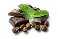 Chocolate, Mint and Coffee Beans. Studio macro of chocolate, fresh mint leaves and coffee beans. Copy space royalty free stock images