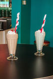 Chocolate And Mint Milkshakes. Milkshakes with whipped cream, cherries and a fancy straw stock images