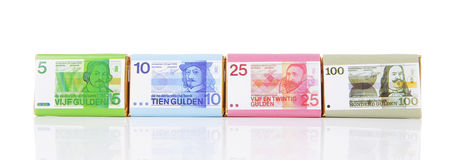 Chocolate money bars with old Dutch money Stock Photos