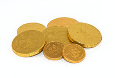 Chocolate Money. Six chocolate coins in gold foil covers Royalty Free Stock Images