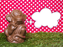 Chocolate monkey on the grass Stock Photography