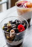 Chocolate Morsels and mixed fruit Parfait with yogurt in glass c royalty free stock images