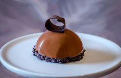 Chocolate mouse cake with a chocolate curl Royalty Free Stock Photography