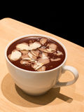Chocolate mousse with almond. In a white cup Stock Photos