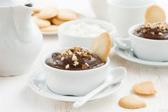 Chocolate mousse with biscuits and nuts in cups Stock Photo