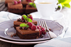 Chocolate mousse brownies with fresh raspberries. Chocolate  mousse brownies with fresh raspberries and chocolate pieces Stock Images