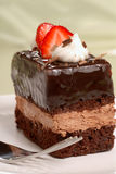 Chocolate mousse cake with cut strawberries Stock Photo