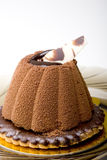 Chocolate mousse cake on a glazed cookie dessert. Chocolate mousse cake on top of a glazed cookie dessert on a glass plate royalty free stock image