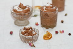 Chocolate mousse. In different glass capacities Royalty Free Stock Photos