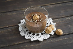 Chocolate mousse with nuts and biscuits Stock Images