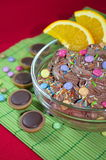 Chocolate mousse with orange. Chocolate mousse with pieces of orange and sprinkles stock photos