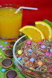 Chocolate mousse with orange. Chocolate mousse with pieces of orange and sprinkles Stock Photography