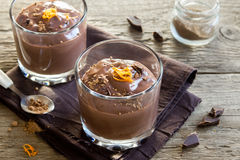 Chocolate Mousse with Orange Zest. Chocolate Mousse topped with Orange Zest in glasses over wooden background close up - delicious homemade Chocolate Pudding Royalty Free Stock Images