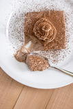 Chocolate mousse portion  in white plate Stock Photography